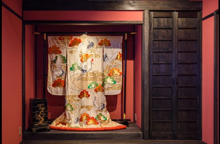 The old traditional wedding kimono in the Tokonoma (alcove) of the Japanese tatami mat room upstairs