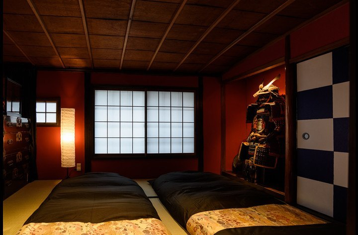 Two futons (traditional Japanese beds) are placed in Samurai Steve's tatami mat room.