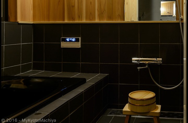 The bathroom, wooden walls and automatic bath control system