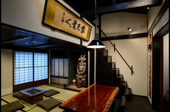 The ground floor, Japanese living space, dining room, box-stairs leading to the loft bedroom, and Samurai Kevin in the alcove