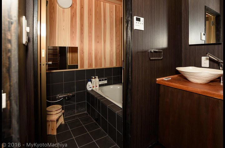 The traditional wooden (cypress) bathroom