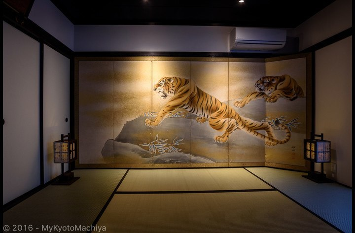 The first Japanese living room downstairs with a large byobu  (panel) representing two tigers