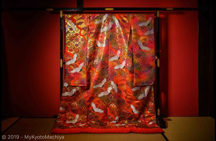 The traditional wedding kimono in the living room.