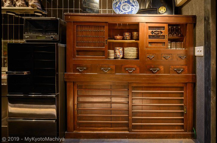 The 1F kitchen cupboard is an antique Kyoto style Mizuya. It is full of plates, glasses, etc.