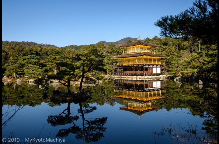 The famous Kinkakuji or Golden Pavilion, a Zen temple in northern Kyoto whose top two floors are completely covered in gold leaf. The reflection on the pond's water doubles its beauty.