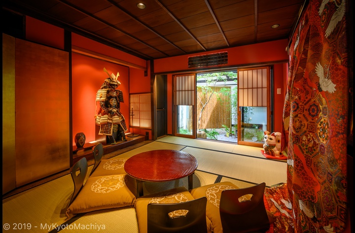 The living room, with Samurai Tom in the Tokonoma (alcove) and the garden in the background.